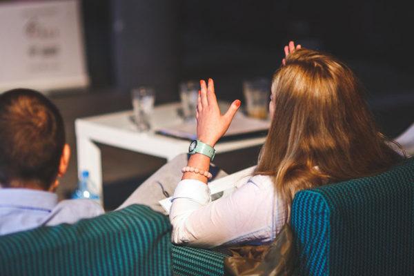 employees-hands-up-meeting-man-woman-aliat