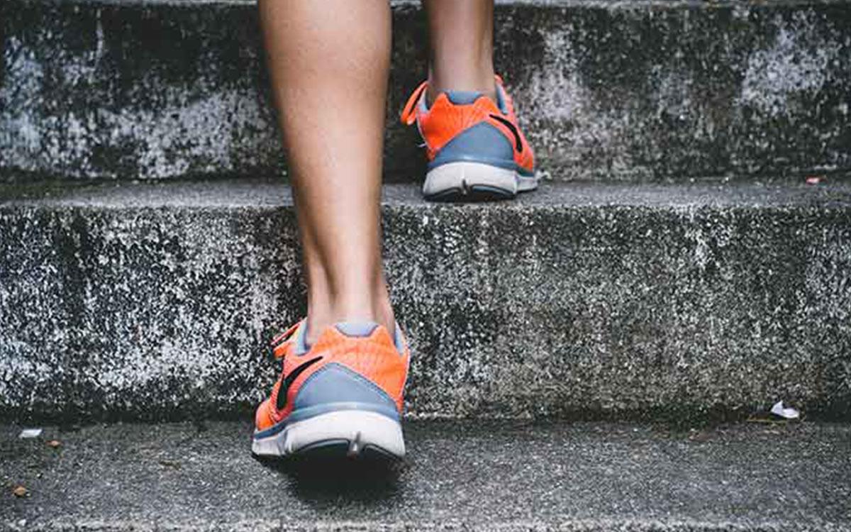 orange-nike-sneakers-walking-upstairs-aliat