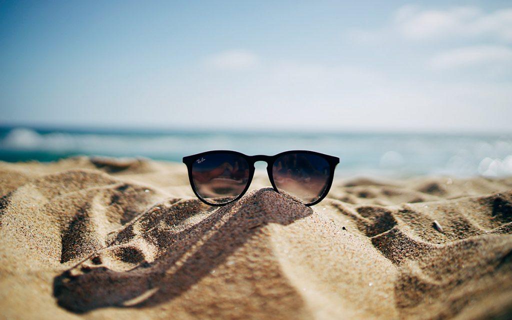 sunglasses-sand-beach-ocean-summer-health-uv-rays-aliat