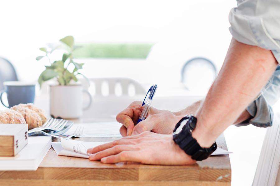 real-benefits-group-writing-pen-man