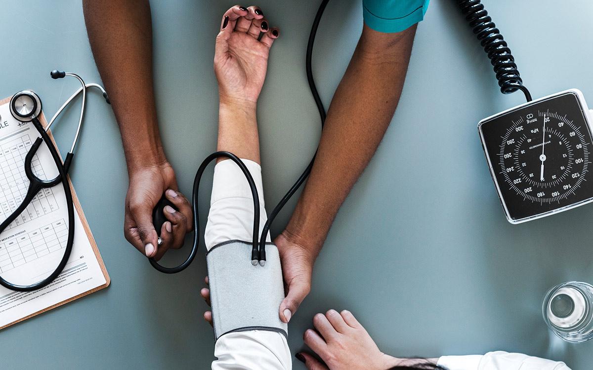 healthcare-doctor-visit-blood-pressure-aliat-professional-employer-organization