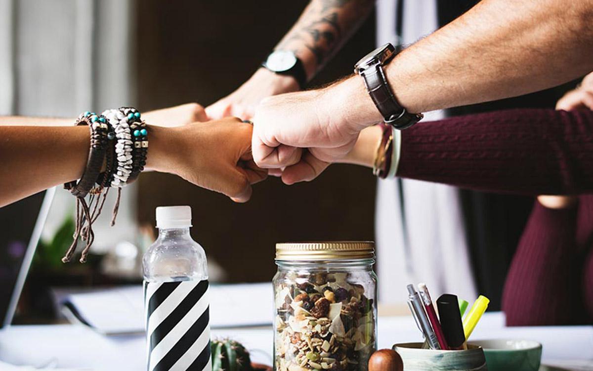 teamwork-hands-together