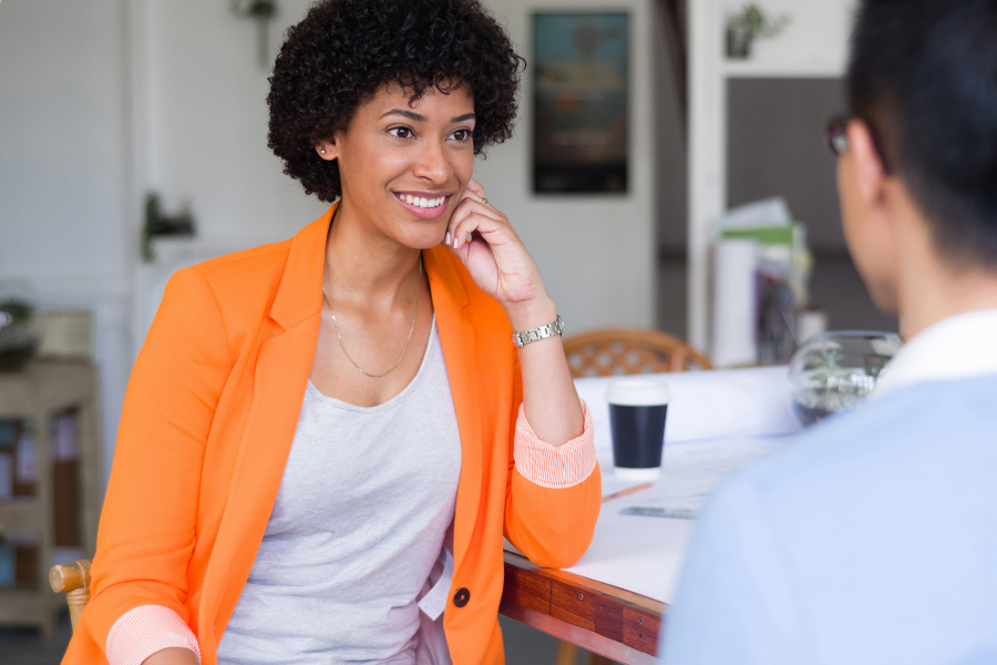 employee-classification-woman-interviewing-man-orange-jacket-aliat-self-employed-independent-contractor-employee-w2-1099